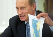 Владимир Путин с картой. Фото AP
