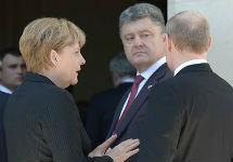 Петр Порошенко, Владимир Путин и Ангела Меркель. Фото пресс-службы Кремля