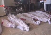 Тела погибших при налете на поселок Тальбиса под Хомсом, 30.09.2015. Кадр видео с youtube-канала talbisa h