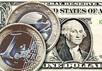 Евро и доллар. Фото АР