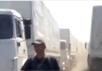"Боевики регулируют движение ""гуманитарного конвоя"". Кадр видеозаписи"