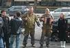 """Участники нападения у входа в Дом кино. Фото: Семен Шешенин/""""Мемориал"""""""