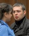 Потерпевший омоновец Иван Круглов и прокурор Костюк в суде. Фото Александра Барошина