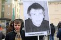 """Бывший """"болотный узник"""" Рихард Соболев со своим портретом на шествии 2 февраля. Фото Евгении Михеевой/Грани.Ру"""