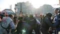 """Продолжается толкотня, Гущин стоит в стороне. Кадр видеозаписи """"184 задержания"""" из """"Болотного дела"""""""