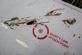 """Следы от осколков ракеты на крыле потерпевшего крушение лайнера Boeing 777. Фото: М.Воскресенский/РИА """"Новости"""""""