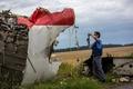 """Поисковые работы на месте крушения Boeing 777. Фото: М.Воскресенский/РИА """"Новости"""""""